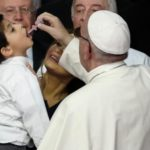 Pope Francis giving a polio vaccine