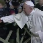 Pope Francis, in pain, being pulled